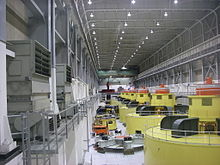 The inside of the Glen Canyon power plant, showing a row of large hydro-electric generators