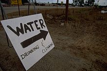 A sign indicating a relief camp providing water for cleaning and drinking