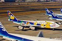 JA8965 2 B747-481D ANA (Pocket Monsters) HND 13JAN99 (6559460693).jpg