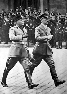 Mussolini walking with Adolf Hitler in Berlin, in military uniforms 1937