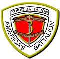 "A white shield with a red interior and a gold border. On the top is written ""Third Battalion"" and on the bottom written ""America's Battalion"". The red interior has a ""3"" in the center with a sword running through it with the words ""Third Marines"" on the top and ""Fortes Fortuna Juvat"" on the bottom."