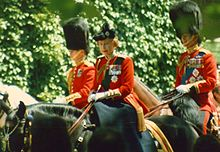 Elizabeth in red uniform on a black horse