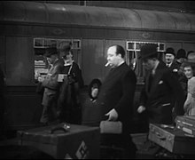 Still from The Lady Vanishes depicting Hitchcock