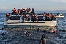 Syrian and Iraqi migrants arriving in Lesbos, Greece in 2015 seeking refuge.