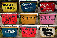 Colorful dumpsters painted with slogans
