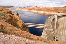 View of Glen Canyon Dam and Lake Powell from the edge of the canyon.