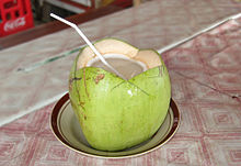 Cut open coconut with straw