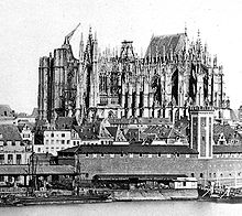 Old photo of the cathedral before completion shows the east end finished and roofed, while other parts of the building are in various stages of construction.