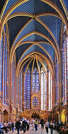 Sainte Chapelle interior showing painted stonework vaulting and stained glass