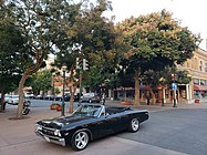 Picture of Main Street in Salinas with a vintage car, holiday lights and trees.