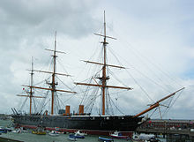A picture of the iron-clad HMS Warrior docked in Portsmouth's historic harbour. The ship has since been restored to its original Victorian condition.