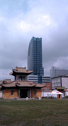 Three types of buildings against a cloudy sky