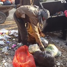 File:Poor men and children scavenge the trash dumps of Kabul's neighborhoods for leftovers and recyclable materials..webm