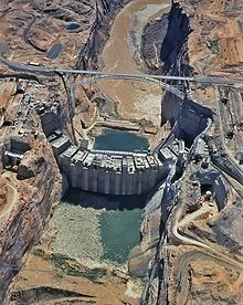 Aerial view of a partially complete Glen Canyon Dam