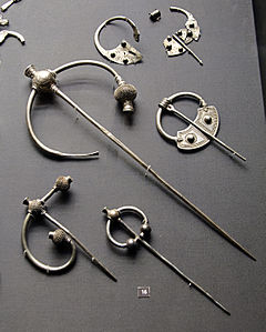 display of silver brooches, some broken up