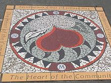 "Mosaic sidewalk art on East Hastings Street, depicting a heart and the Community ""The Heart of the City"""