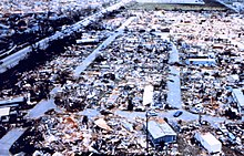 An aerial view of destroyed mobile homes with copious amounts of debris