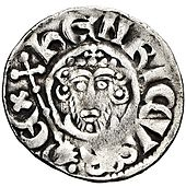 "A photograph of the ""heads"" side of a silver King John penny"