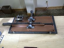 A photograph of a hand-cranked machine
