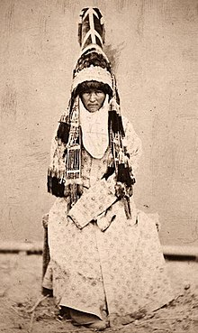Old photo of a bride, completely covered except for her face