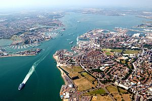 An aerial view of western side of Portsmouth (including Gunwharf Quays, the dockyard and the Spinnaker tower), the harbour itself, and the town of Gosport.