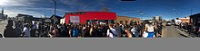 Panoramic photo of protest in Five Points, Denver