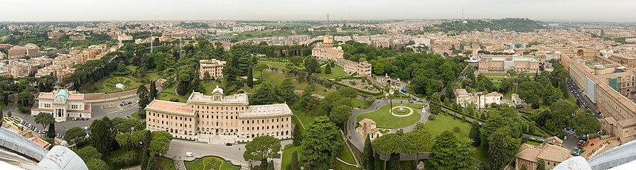 A panorama of gardens and several buildings from atop St. Peter's Basilica