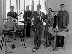 The Rentals in the Friends of P. music video.jpg