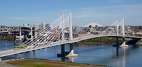 Tilikum Crossing with streetcar and MAX train in 2016.jpg