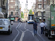 Public transport, goods delivery, private transport and pedestrians in Leidsestraat, Amsterdam
