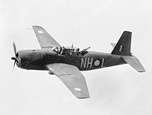 Black and white photo of a single-engined military monoplane in flight