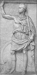 A monochrome relief stele depicting a man in classical Greek clothing raising one arm